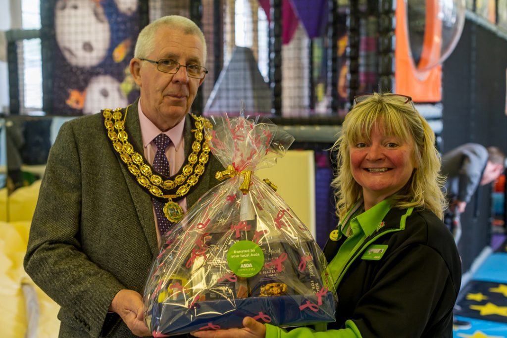 Cllr Jones receives a raffle prize from Asda. Presented by their community champion Lisa.